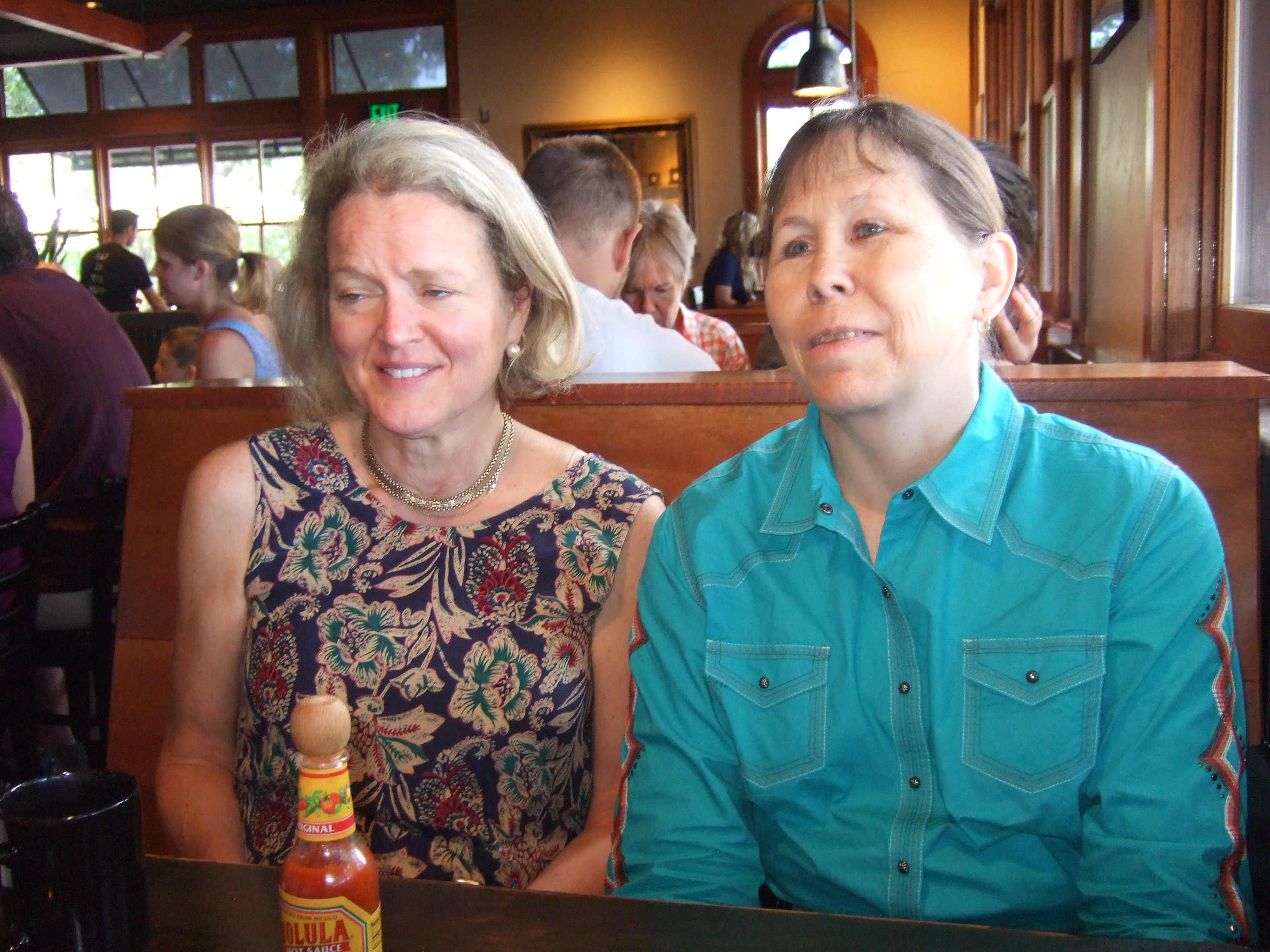Narrator/actress, Maartha Harman-Pardee and writer, Donna R. Grahmann breakfasting in The Buff Restaurant