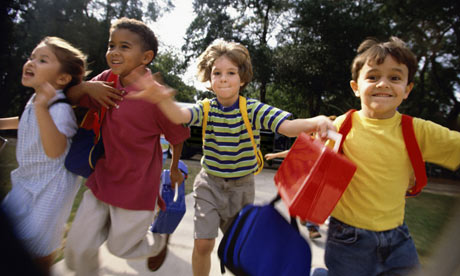Picture of children with backpacks running to school!